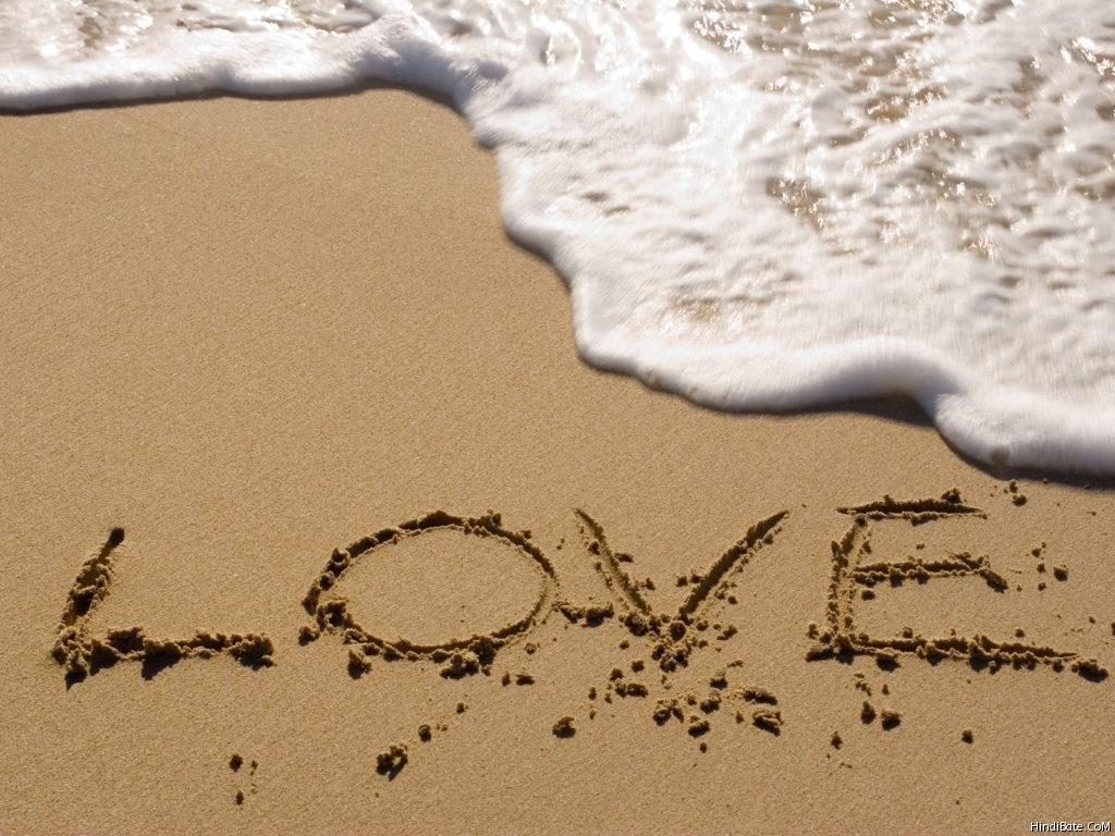 Love word in sand on beach